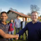 Wallingford CC chairman Shan Rahulan (left) and Blewbury Village Community Interest Company director Derek Watson (right) outside the new pavillion at Blewbury with looking on (from left) Blewbury Village Community Interest Company director Anita Prosser,