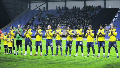Oxford 's players during the minute's applause for Fabrice Muamba before Tuesday's game with AFC Wimbledon