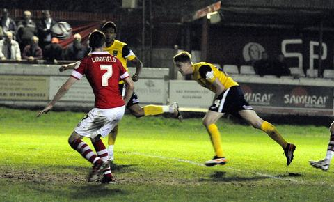 Asa Hall scores his second goal for United at Accrington