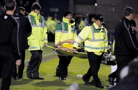 Oxford United's Peter Leven is stretchered off