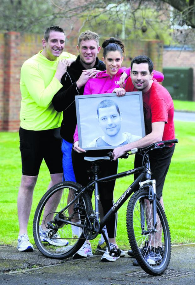 From left to right, James Field Pricey, 24, Luke Allen, 24, Victoria Mitchell, 24, and brother Anthony Rowbottom, 26, holding a picture of Adam