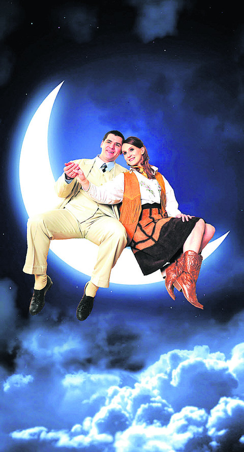 Swinging on the moon . . . Show stars Duncan Blagrove, as Bobby Child, and Sally Hall as Polly Baker