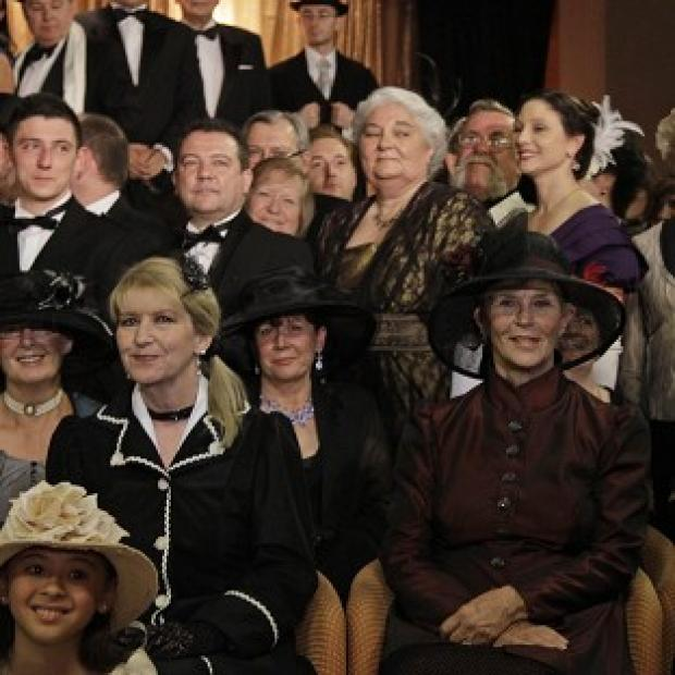 Passengers in costumes pose following a reception at the MS Balmoral Titanic memorial cruise ship (AP)