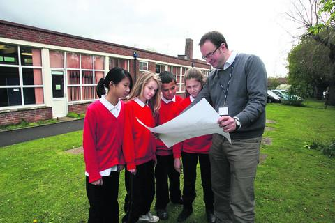 Cutteslowe headteacher Jon Graywith Year Six pupils, from left, Hayley Tse, Holly Downing, Zane Ladhani and Idil Mignon and plans for the new school buildings