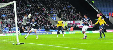 Southend keeper Cameron Belford gathers safely as Andy Whing (right) and Michael Duberry look on