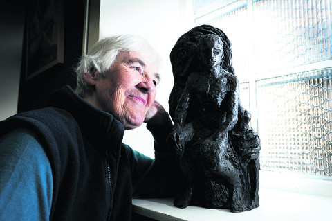 Sister Bridget, pictured with her sculpture of St Alban