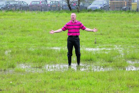 Brian Cooper in the field where houses are set to be built