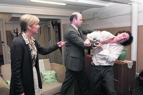 Making a point . . . Billy, played by Harry Forward, right, on the receiving end from dad Geoffrey, played by Keith Ral