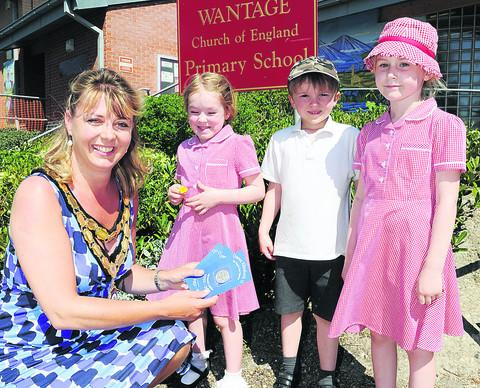 GOLDEN JUBILEE: Mayor hands out coins at schools