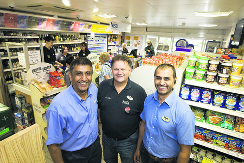 Part of the community: Owners Bhavesh Patel, left, and Manoj Rajgor, right with manager Paul Whitman