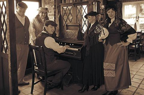 Victorian era . . . From left to right, performers John Robertson, Jane Murphy, Ali Bagshaw playing the piano, Jane Wilson and Andrea Adamson
