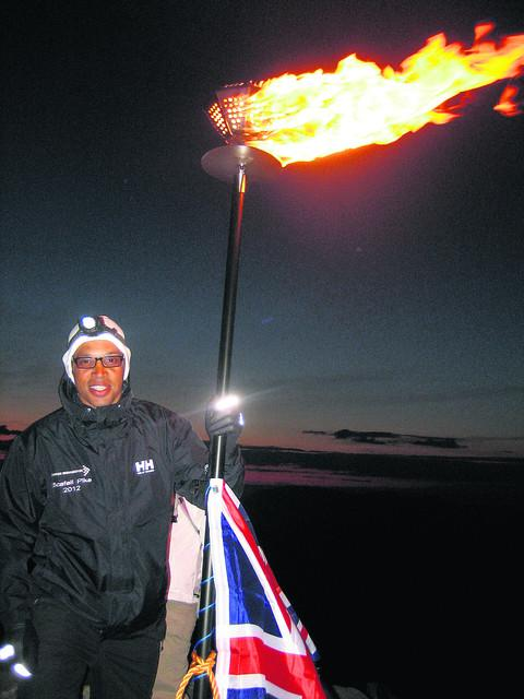 James Chadney with the beacon at the top of Scafell Pike