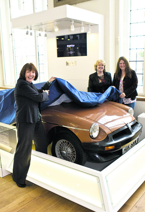 Town councillor Julie Mayhew Archer, curator Jane Bowen and museum officer Adela Thomas unveil the last MG made in Abingdon
