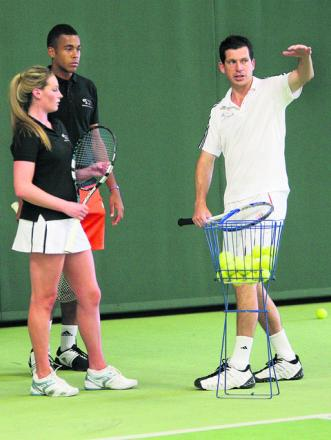 Henman helps out young stars
