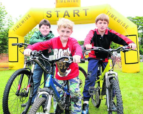 Liam Concannon, 11, Stanley Tibbetts, nine, and 10-year-old Billy Tibbets took part in the cycling event