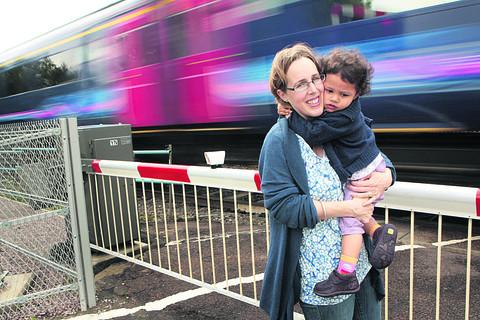 Alex Jacob has raised fears over the safety of the level crossings in Steventon after her daughter Elizabeth, two, managed to get through a gap in the barrier