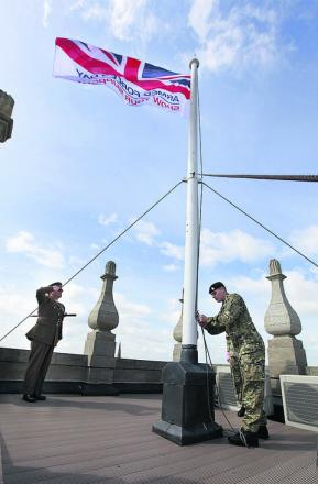The flag being raised yesterday at the County Hall Museum in Abingdon. Picture: OX52715 Antony Moore