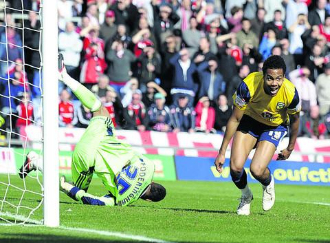 Oli Johnson scores in Oxford's 2-0 win over Swindon in March. Johnson has joined York for next season