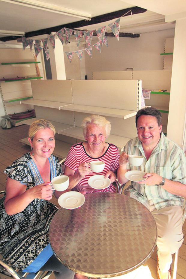 Herald Series: Natasha Kingsbury, left, Chris Ricketts and Mike Hudson in the new community shop and cafe being opened in Marcham
