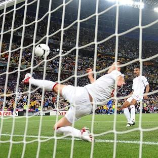 England's John Terry clears ball from beyond goal-line in Euro 2012 clash against Ukraine
