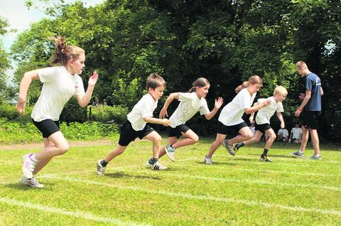 Herald Series: Katie Cording, William Timbrell, Hermione Jewell, Charlotte Thornton and Ben Long, from Radley Primary School, at the Olympics sports day. Picture: OX52568 Antony Moore