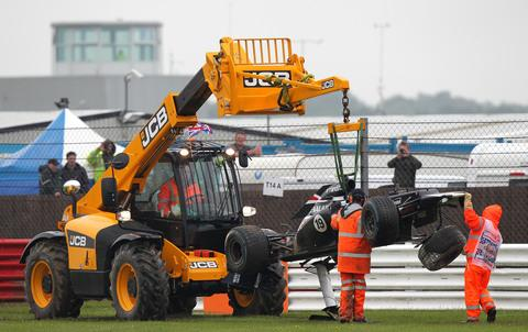Bruno Senna's badly damaged Williams is winched away after the crash at Silverstone