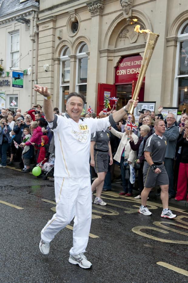 Raymond Blanc carries torch through Wallingford town.