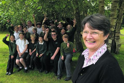 Retiring head Liz Robertson with children at Uffington Primary School