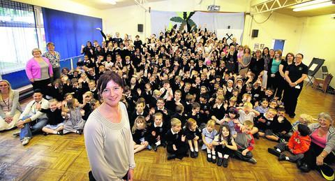 Chalgrove Primary School headteacher Julie Quarrell, front, with staff and children