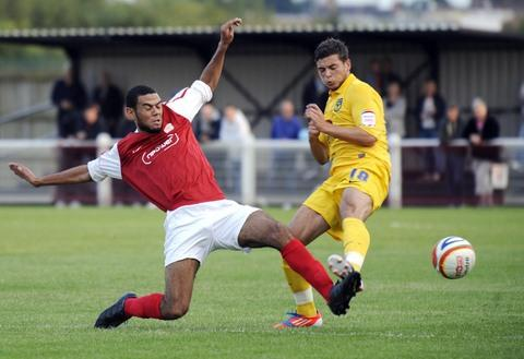 Oxford United 's Jake Forster-Caskey (right) battles it out with Lance Williams during last night's 1-1 draw at Didcot Town
