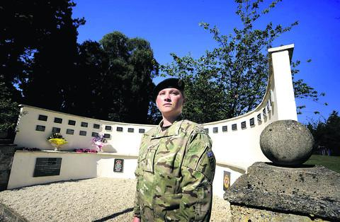 Captain Jayne Reynolds at the memorial wall bearing the names of fallen soldiers from Didcot's Vauxhall Barracks
