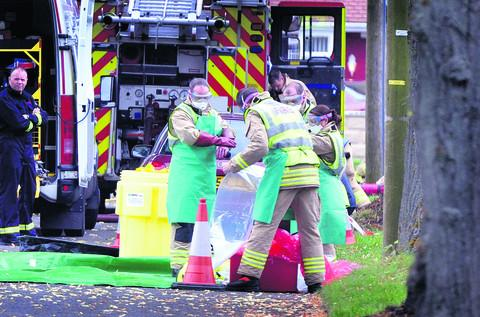 Emergency services put on protective clothing at Park Close in Didcot