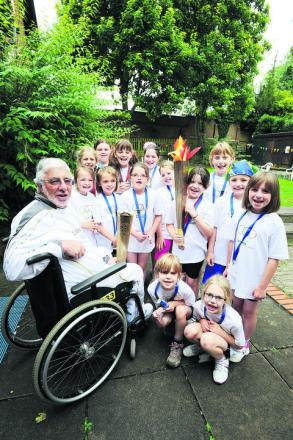 Olympic torchbearer Malcolm Fretter with members of the 8th Abingdon Brownie Pack