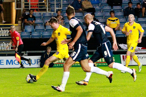 Tom Craddock races through to fire home his and Oxford United's second goal of the game against Southend last night