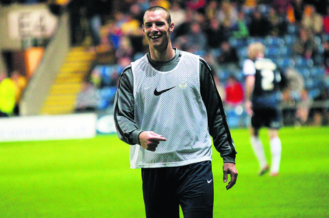 ALL SMILES: Substitute James Constable warming-up for United last night