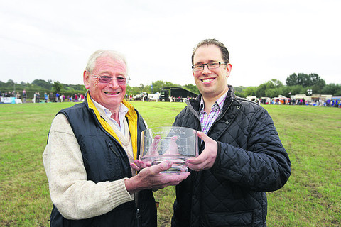 Council leader Matthew Barber, right, presents the Freedom of the Vale to White Horse Show organiser, Derek Kelsey
