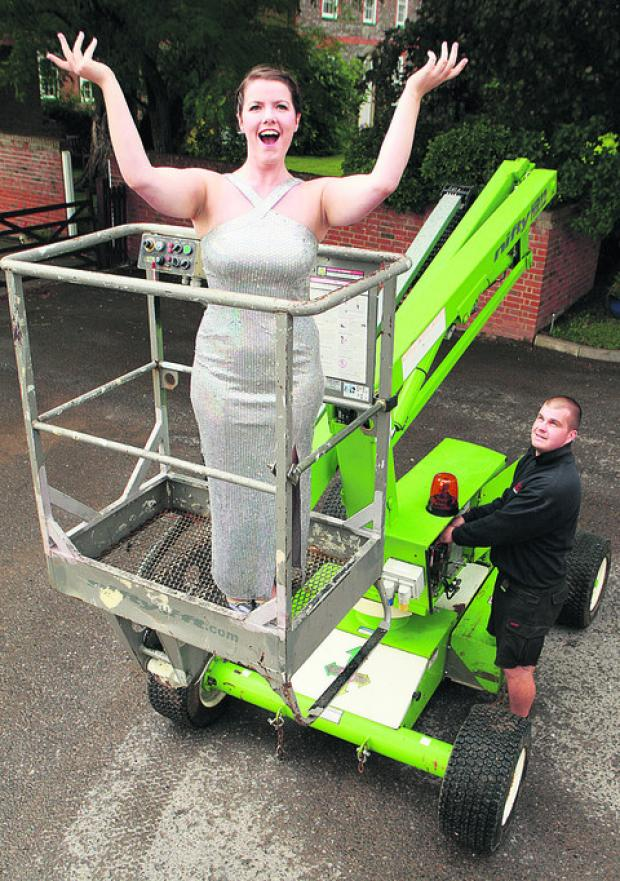 An am dram group are using a cherry picker in their play. Grace Anderson plays Little Voice. Lee Wise of Cannings operates the lift
