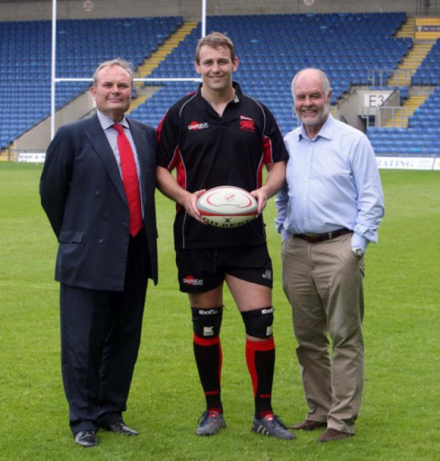 From left, London Welsh chairman Bleddyn Phillips, captain Jon Mills and managing director John Taylor at the Kassam Stadium