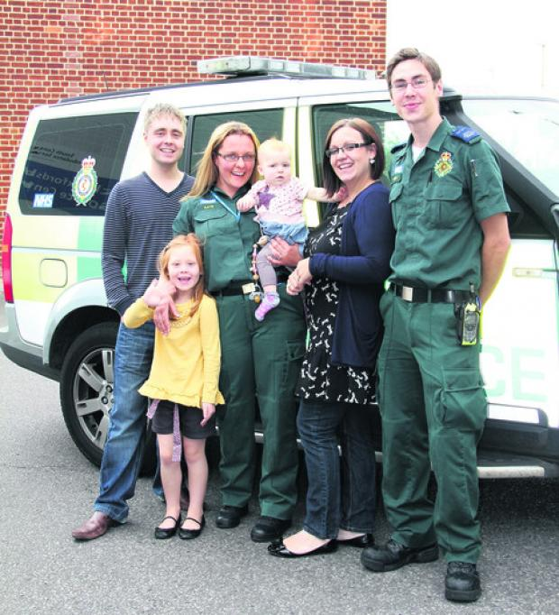 Baby Eloise Wilmshurst with sister Abigail, parents Michael and Charlotte, ambulance technician Kate Ellis and emergency care assistant Mike Buckland