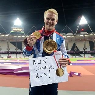 Jonnie Peacock celebrates with his gold medal in the Men's 100m - T44 Final during the Paralympic Games in London