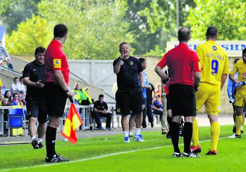 James Constable is sent off by referee Jeremy Simpson, much to the amazement of Oxford United boss Chris Wilder, who makes his point to the official