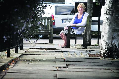 Abingdon town councillor Penny McDougall with uneven slabs