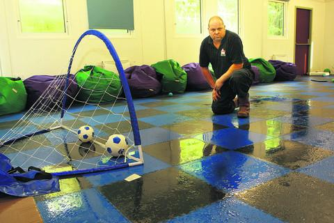 Gary Thorne inside the Scout hut where water leaks into the building     Pictures: OX53987 Antony Moore