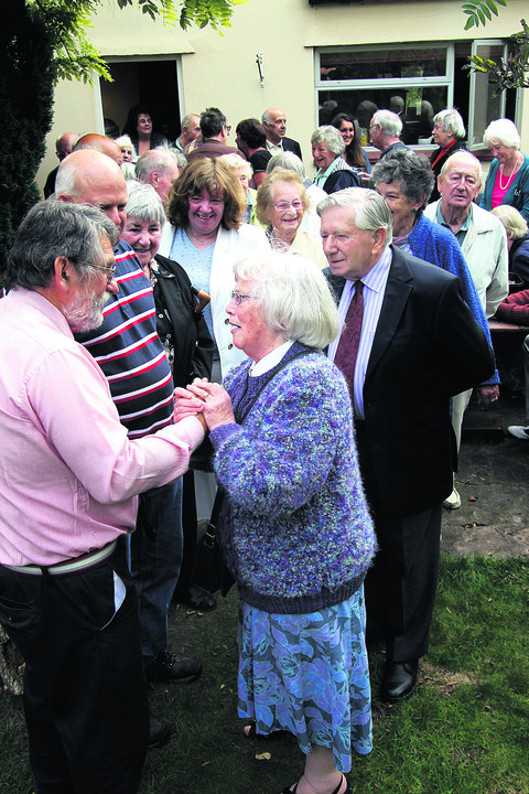 Retired GP Dr Leszek Blazewicz, front left, greets ex-nurse and patient Edna Ashwell, 80, at his tea party. Picture: OX54143 Ric Mellis