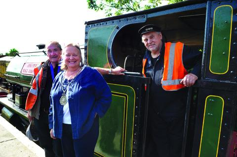 Malcolm Simpson, 71, pictured right, with chairman of Darlington Railway Preservation Society Barry Lamb and Wallingford mayor Ros Lester. Picture: OX54370 Denis Kennedy