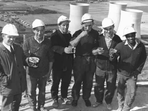 Herald Series: This group of workers at Didcot Power Station celebrate to mark the completion of their work on the chimney in 1968