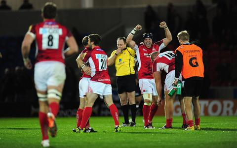 Dan George leads the London Welsh celebrations after theirwin at Sale