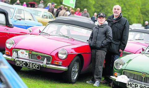 Andy Shonhard and his son Jamie, 12, with their 1968 MGB Mk I. Mr Shonhard was born in the same year the MGB began to be manufactured