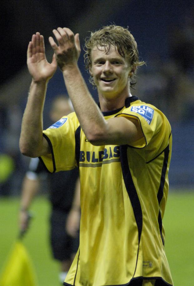 Alex Fisher celebrates scoring for Oxford against Portsmouth