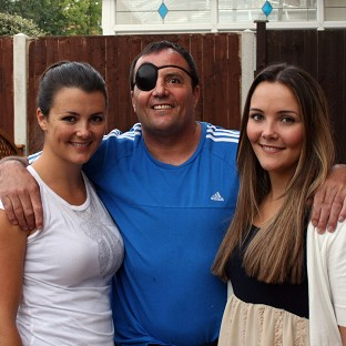 Pc Diederik Coetzee, pictured with his daughters Lauren and Rachel, was nicknamed RoboCop for his work on a city estate